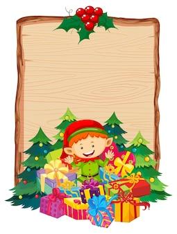 Leeres holzbrett mit frohe weihnachten 2020 schriftlogo und elfengeschenk