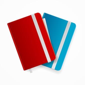 Leeres schreibheft-vorlagenset mit gummiband und lesezeichen. rot und blau