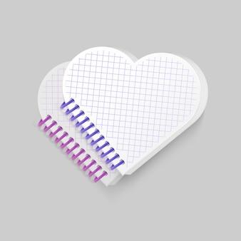 Leeres spiralblock-notizbuch mit herzform
