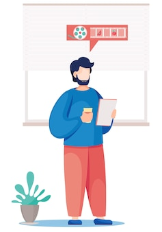 Lehrer an der tafel. der junge männliche lehrer steht mit einer tasse kaffee und einem blatt papier in den händen.