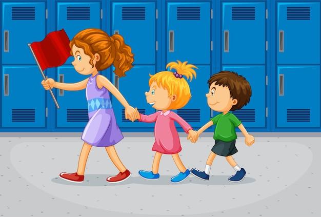Lehrer und schüler am flur der schule