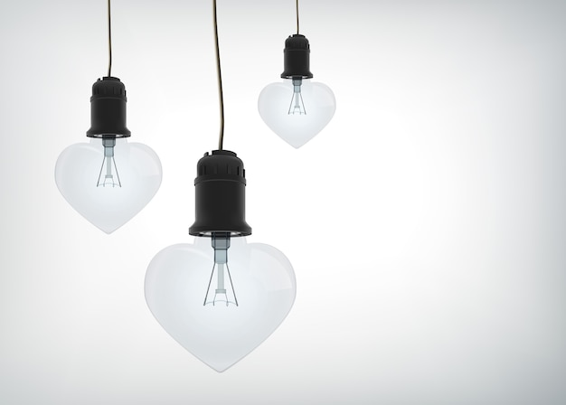 Leichtes verliebtes designkonzept mit realistischen glühbirnen in herzform, die an isolierten drähten hängen