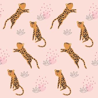 Leopardenmuster mit tropischen blättern nahtlos
