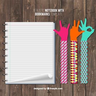 Lesezeichen mit den händen und einem notebook
