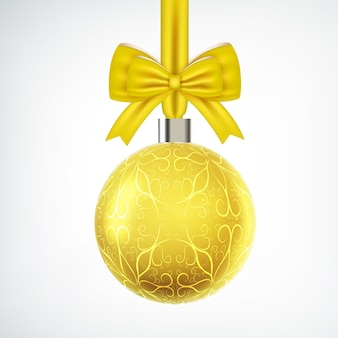 Leuchtend gelbe weihnachtskugel mit bandschleife auf weiß