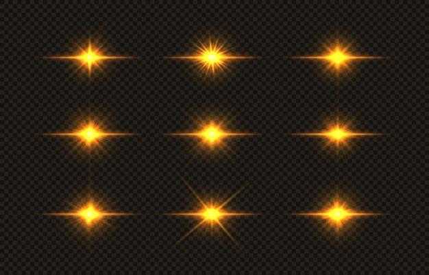 Leuchtende goldene sterne, deren licht leuchtet, explodieren