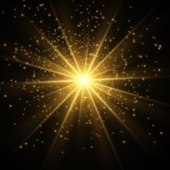 Leuchtende goldene sterne isoliert auf schwarz. effekte, blendung, linien, glitzer, explosion, goldenes licht.