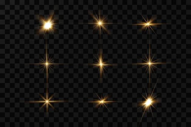 Leuchtende goldene sterne lokalisiert auf schwarzem hintergrund. effekte, blendung, linien, glitzer, explosion, goldenes licht.