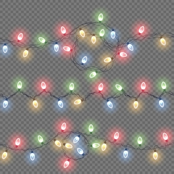 Leuchtende lichter für weihnachtsfeiertagskarten, banner, poster, webdesigns. lichter isoliert realistische designelemente. satz farbige girlanden, feiertagsdekorationen.