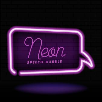 Leuchtender leerer sprechblasenrahmen des neons. rechteck leere sprechblase im neonstil auf dunklem backsteinmauerhintergrund.