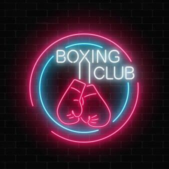 Leuchtendes neon-boxclub-zeichen in kreisrahmen auf dunkler backsteinmauer fighting club-neonschild.