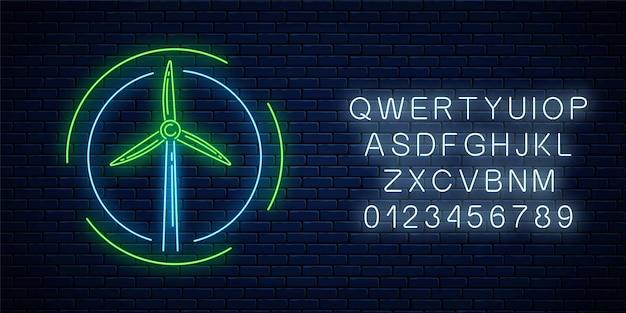 Leuchtendes neonzeichen der windmühle in kreisrahmen mit alphabet auf dunklem backsteinmauerhintergrund.