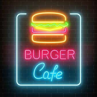Leuchtendes schild des neonburger-cafés auf einer dunklen backsteinmauer. helles anschlagtafelzeichen des fastfoods.
