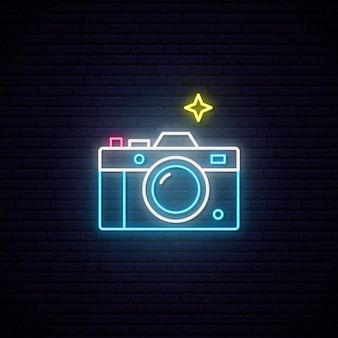 Leuchtreklame des fotokamerazeichens.