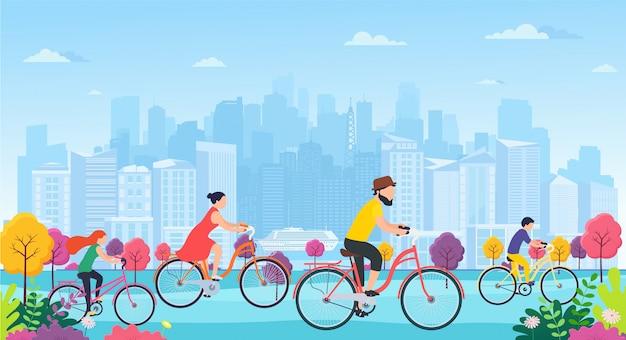 Leute auf fahrrädern im park. familie mit kindern sport und outdoor-aktivitäten. panorama-stadtgebäude betrachten ökologisch sauberen stadtpark.