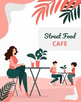Leute-besucher, die im modernen sommerzeit-café sitzen