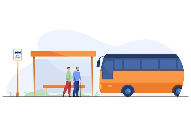 Leute, die an der bushaltestelle auf bus warten