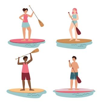 Leute, die auf sup-boards stehen, packen