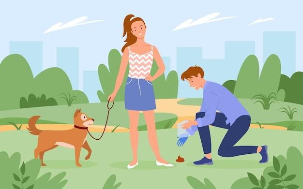 Leute, die aufräumen, nachdem hundehaustier mit tier im grünen parkhintergrund der sommerstadt spazieren gegangen ist