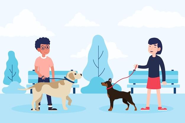 Leute, die den hund im park spazieren gehen