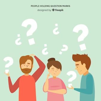 Leute, die fragezeichen halten