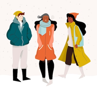 Leute, die gemütliche winterkleidung tragen Premium Vektoren