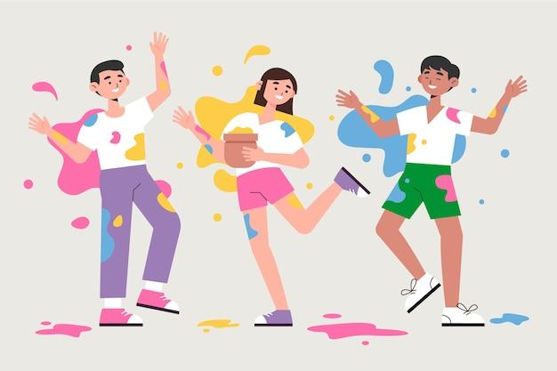 Leute, die herumalbern und zusammen holi festival tanzen