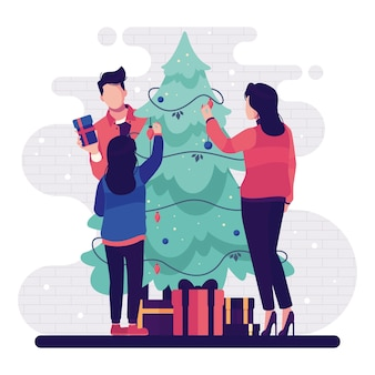 Leute, die weihnachtsbaum mit lichterketten und geschenken verzieren