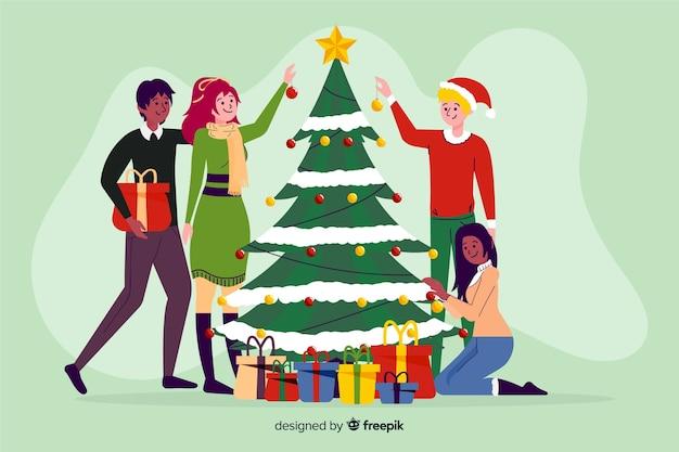 Leute, die weihnachtsbaum verzieren