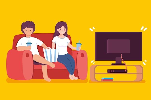 Leute, die zu hause einen film schauen