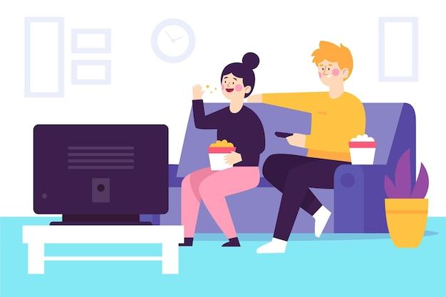 Leute, die zu hause zusammen einen film schauen