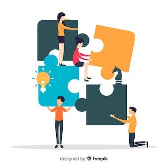 Leute, die zusammen puzzle machen