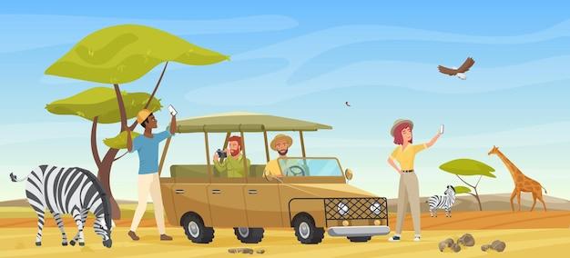 Leute in der wilden savannelandschaft der safaritour mit einer gruppe von touristen machen reisefoto