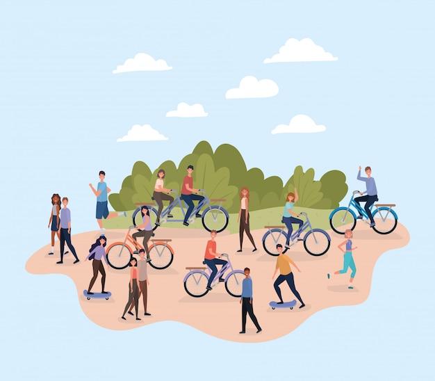 Leute mit fahrrädern und skateboards im park