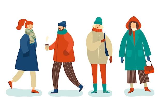 Leute, welche die winterkleidung veranschaulicht tragen