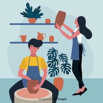 Leute zu hause, die keramik machen