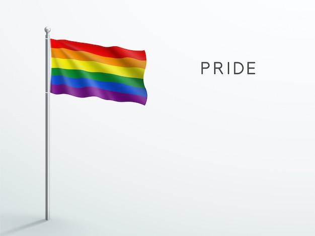 Lgbt gay pride regenbogenfahne winkt auf fahnenmast