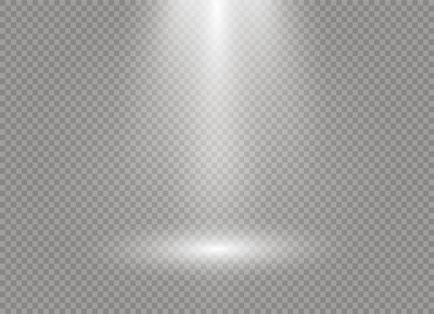 Licht aus dem scheinwerferlicht scheint auf die bühne.