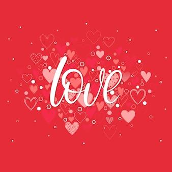 Liebe - handgemalte schrift mit verschiedenen herzen.