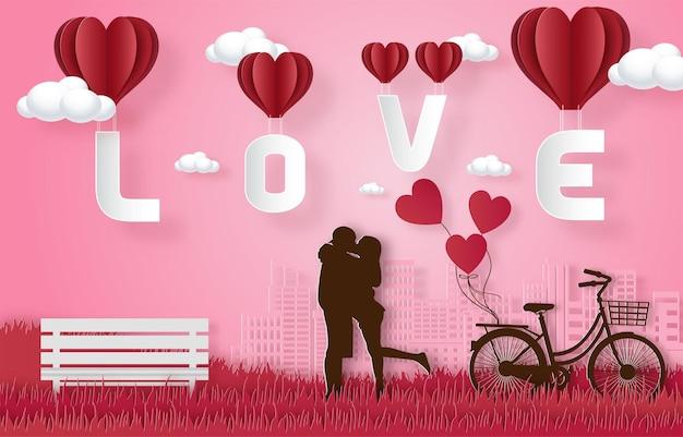 Liebe und glückliche valentinstagbanner, papierkunstartvektorprämie