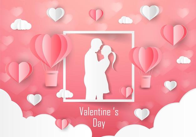 Liebe und valentinstag liebhaber stehen auf den wiesen und ein papierkunstherz