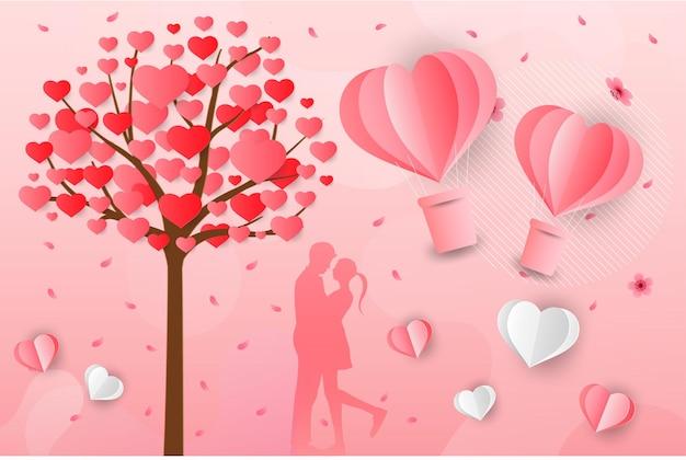 Liebe und valentinstag liebhaber stehen auf den wiesen und einem herzförmigen papierkunstballon