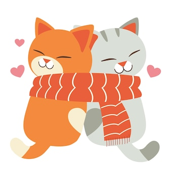 Liebende süße katzen tragen einen großen schal