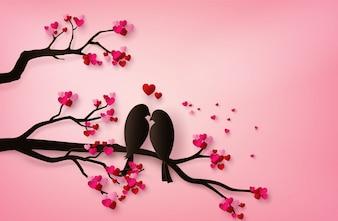 Liebes-Vögel hockten auf einer Niederlassung eines Baums.