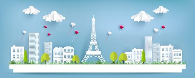 Liebesballons fliegen über die stadt und den eiffelturm. papierkunstentwurf. fröhlichen valentinstag