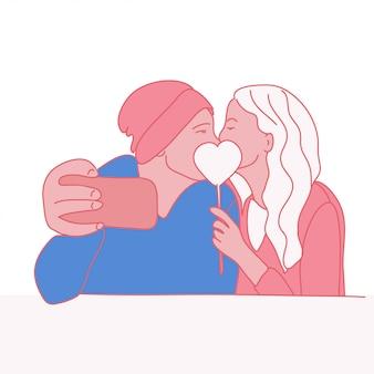 Liebespaare, die ein selfie küssen und nehmen.