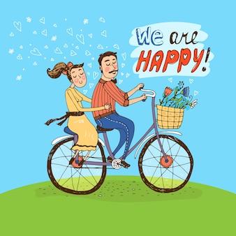 Liebevolles paar, das auf einem fahrrad über einem grünen hügel mit in der luft schwebenden herzen und blumen im korb und den wörtern reitet
