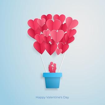 Liebevolles paarfliegen in einem ballon in form einer herz valentinsgrußtagesgrußkarte