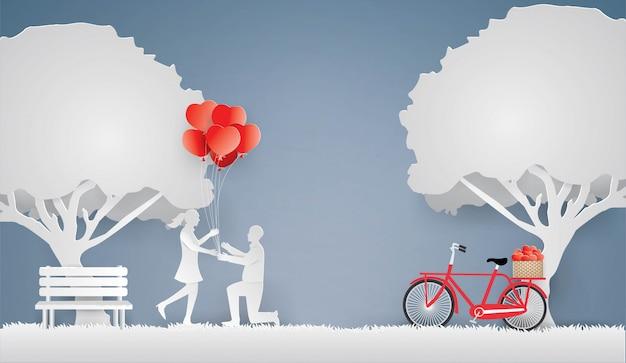 Liebhaber geben ein geschenk als herzförmige ballonsaison im frühjahr