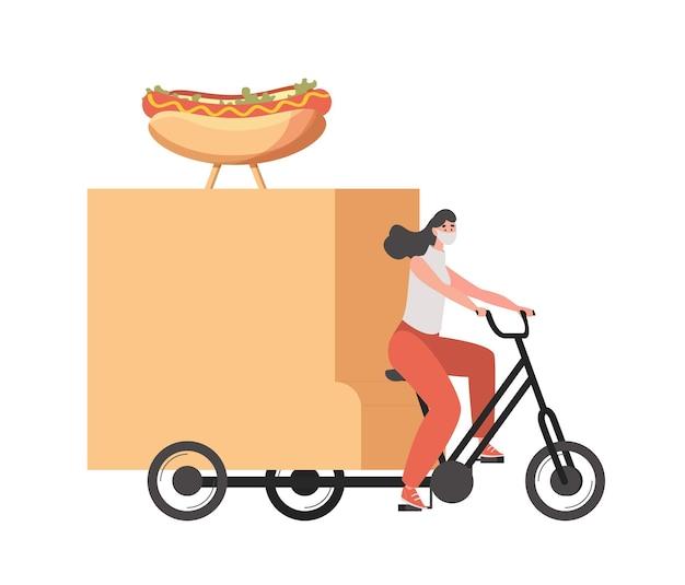 Lieferfrau in der medizinischen gesichtsmaske, die auf fahrrad und reitet